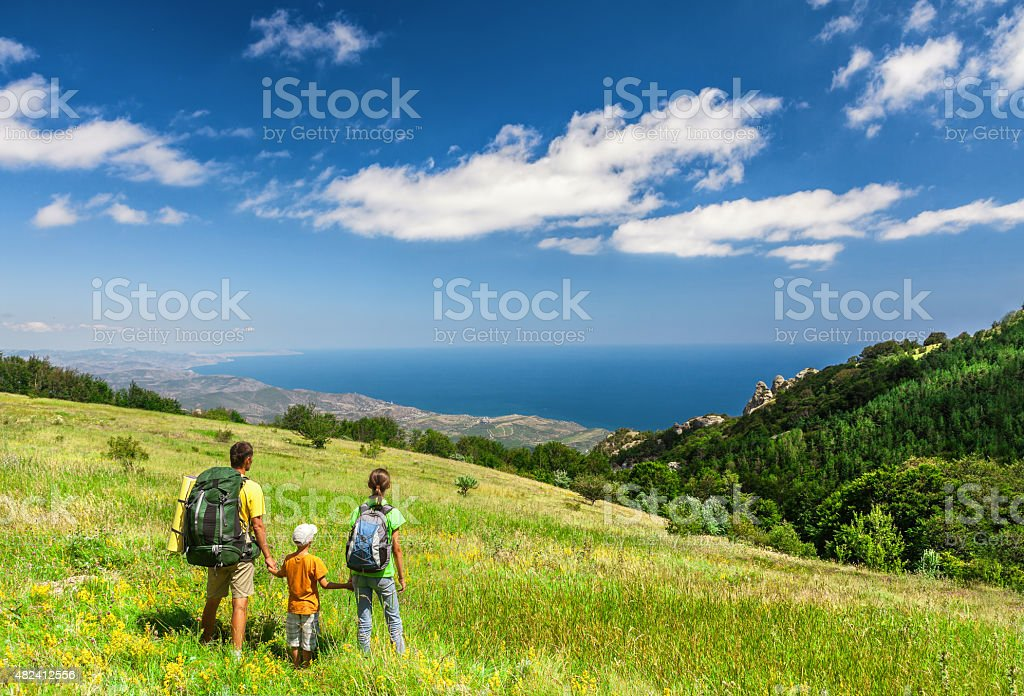 Family walking on field stock photo