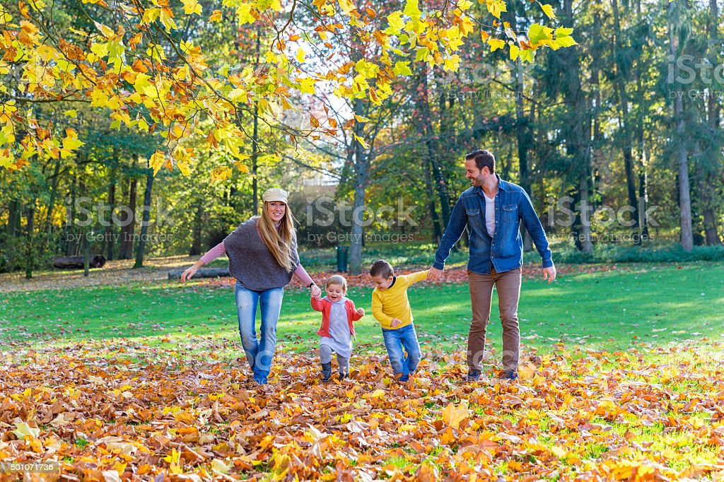 Family walking on leaves stock photo