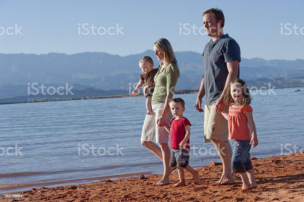 Family walking on the beach. royalty-free stock photo
