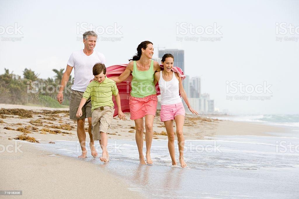 Family walking on the beach stock photo