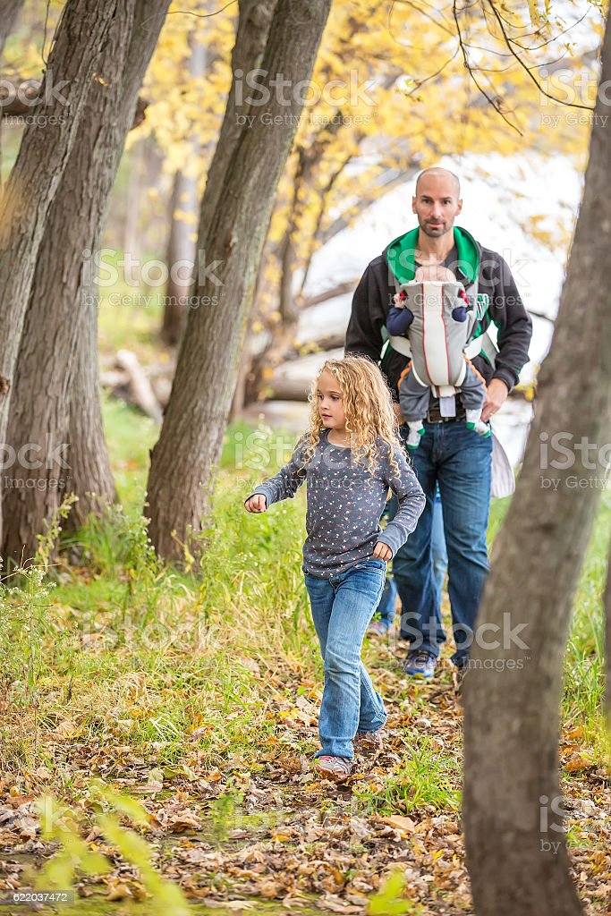 Family Walking Through Woods Next to Mississippi River stock photo