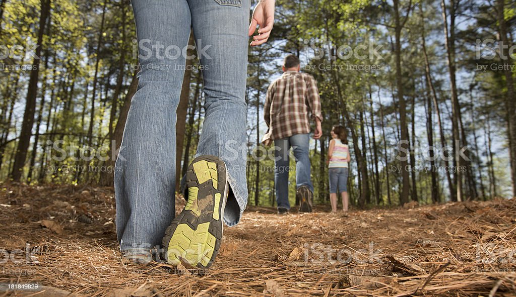 Family walking thru the woods royalty-free stock photo