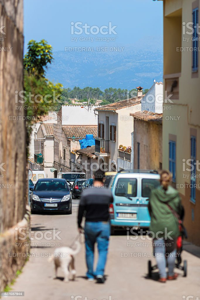 family walking trought streets at city market in Sineu Mallorca stock photo