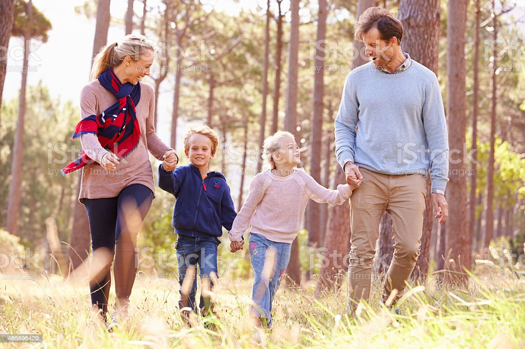 Family walking walking in the countryside stock photo