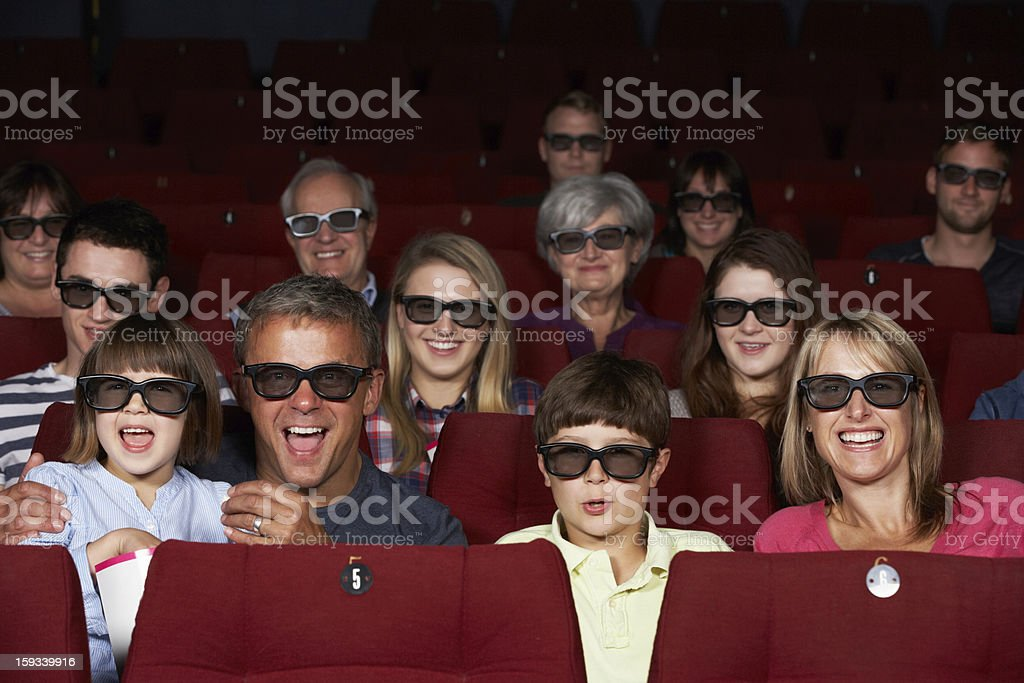 Family Watching 3D Film In Cinema royalty-free stock photo