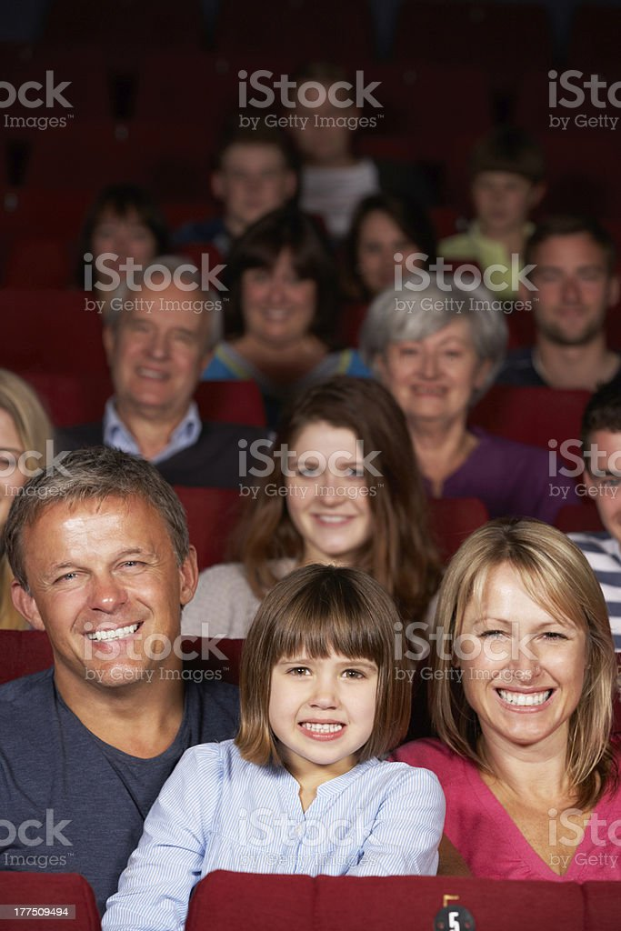 Family watching film in cinema royalty-free stock photo
