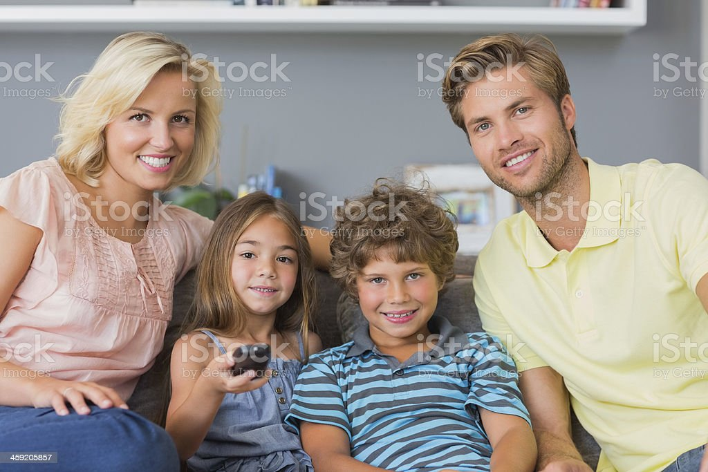 Family watching television together royalty-free stock photo