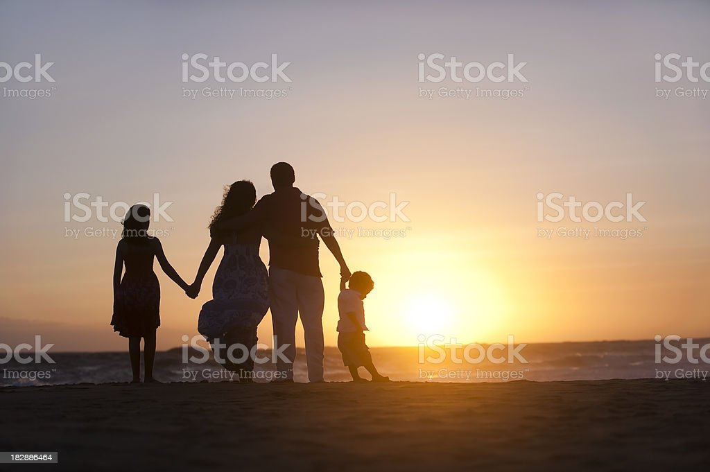 Family watching the sunset stock photo