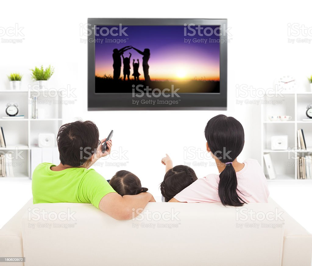 family watching the tv in living room royalty-free stock photo