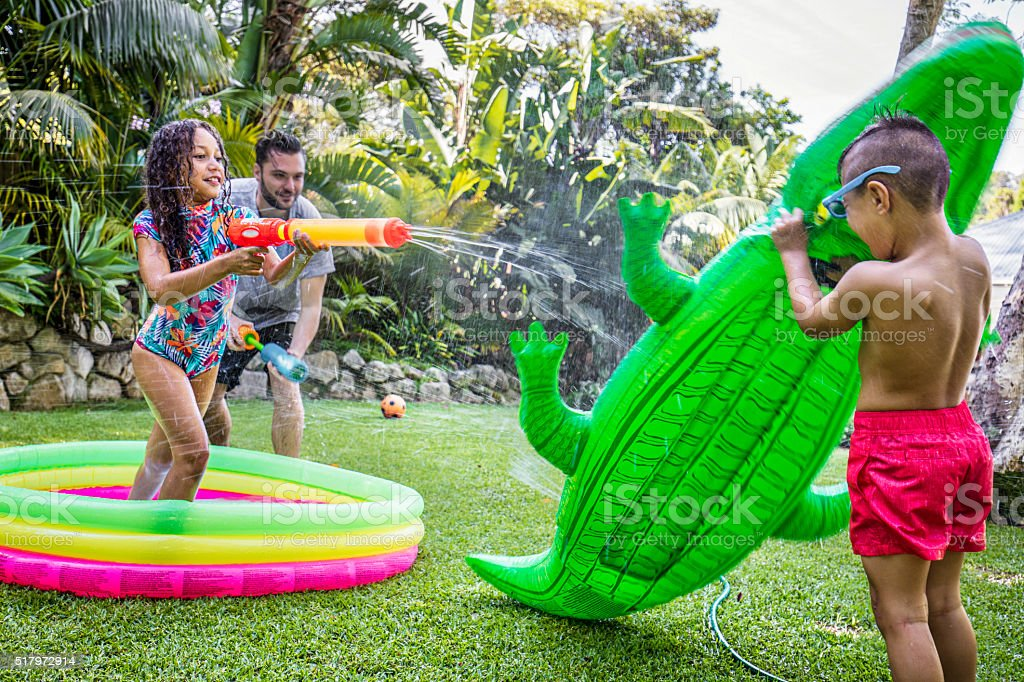 Family Water Fight stock photo