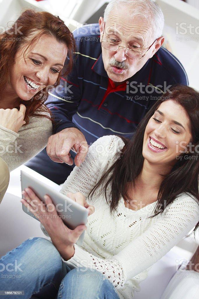 Family wathcing photos royalty-free stock photo