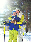 Family winter healthy lifestyle! Mother and son child go skiing