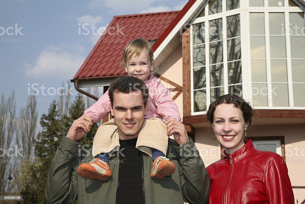 family with baby and house royalty-free stock photo