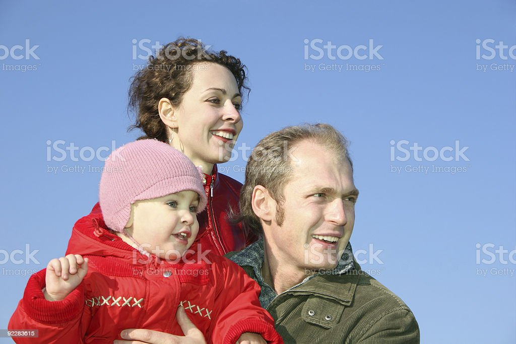 family with baby face on spring sky royalty-free stock photo