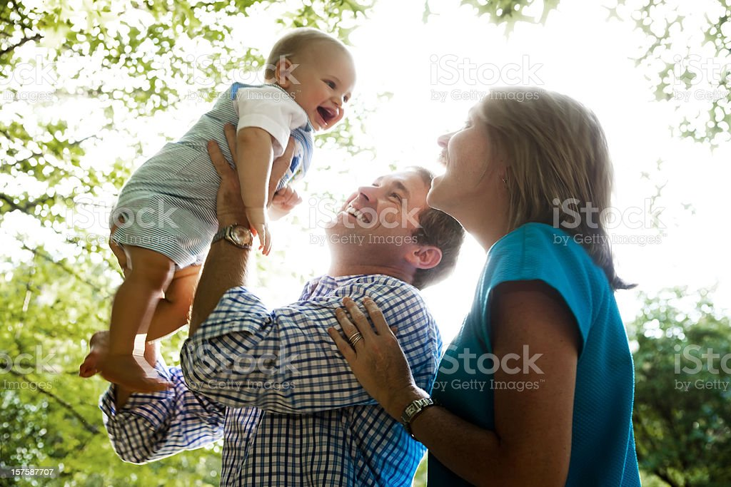 Family with Baby Outdoors stock photo