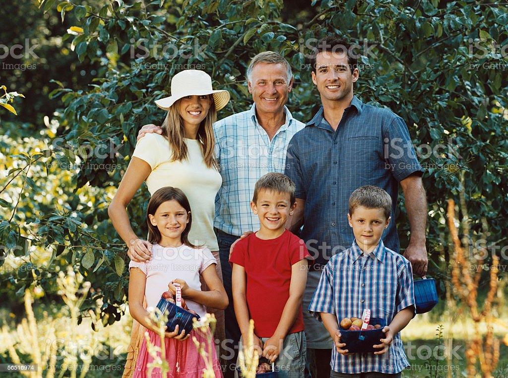 Family with baskets of fruit royalty-free stock photo