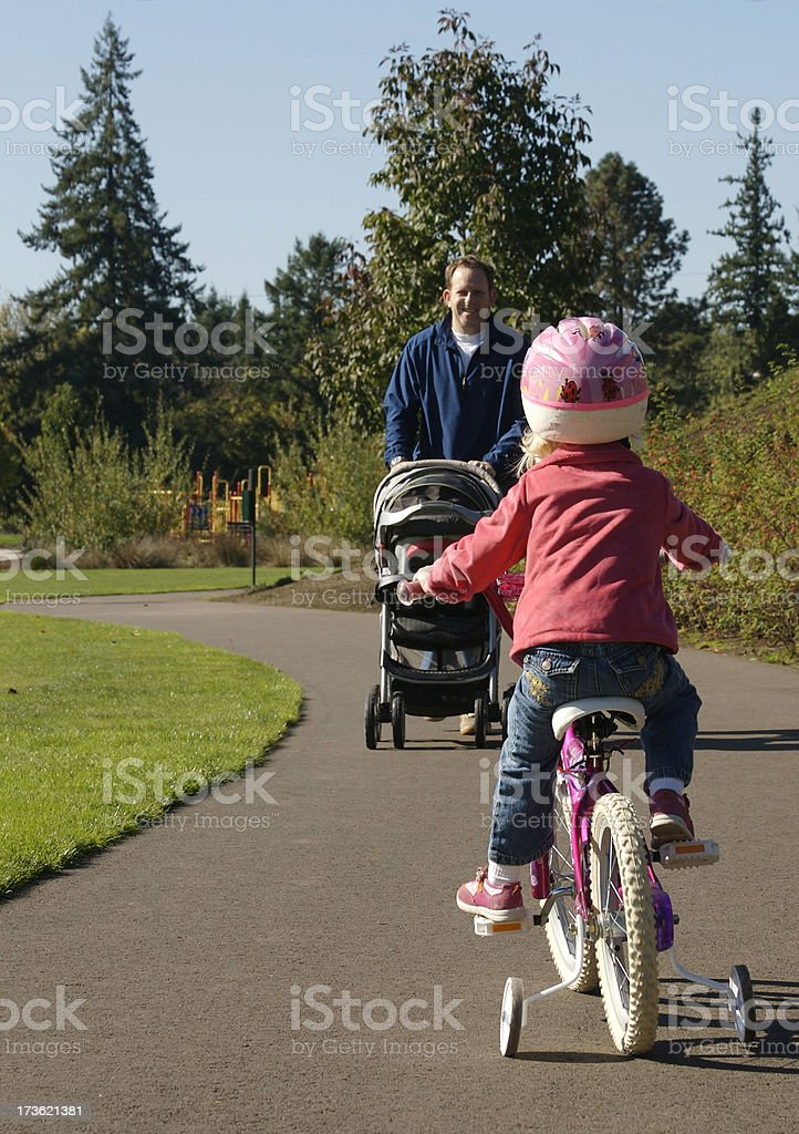 Family with bicycle and stroller stock photo