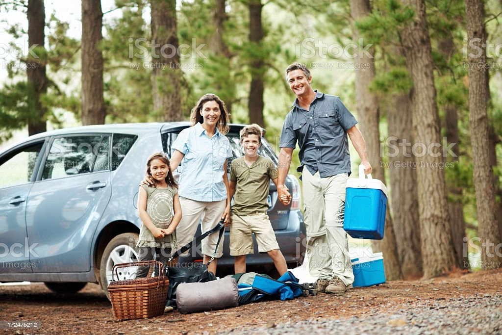 Family with camping gear ready to set up camp royalty-free stock photo