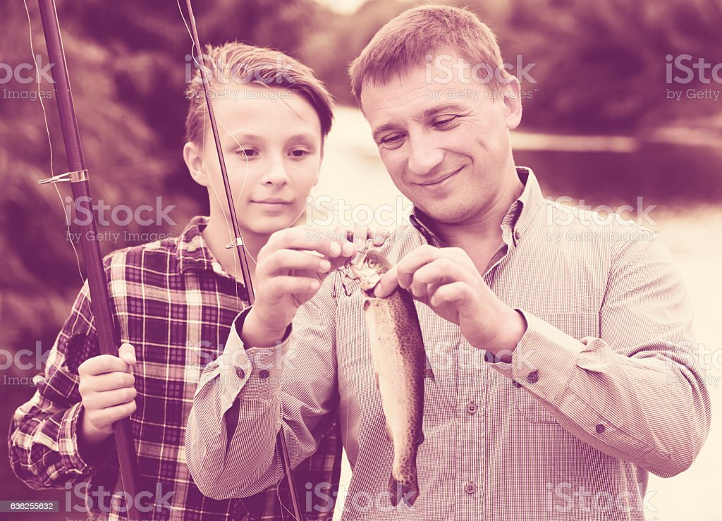 Family with catched fish stock photo