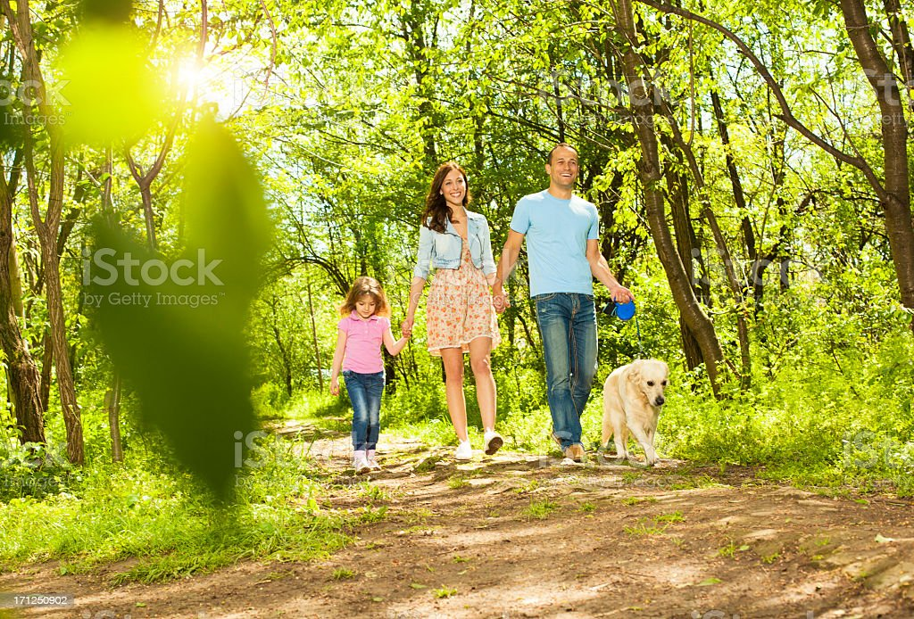 Family With Child and dog Walking Outdoors. royalty-free stock photo