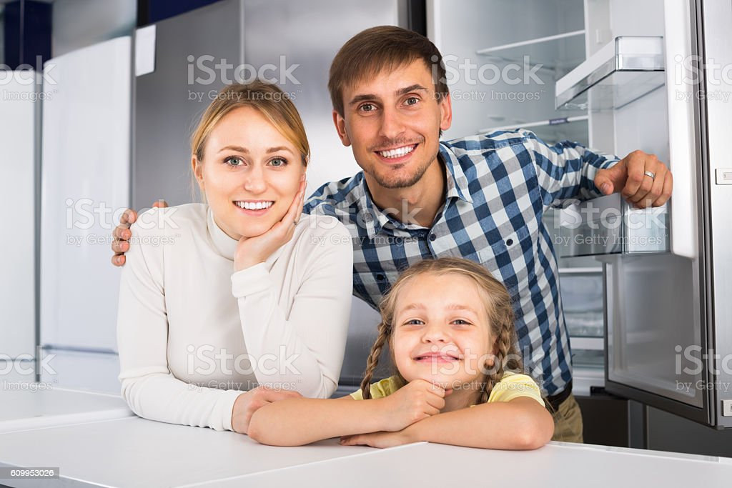 Family with child together in store stock photo