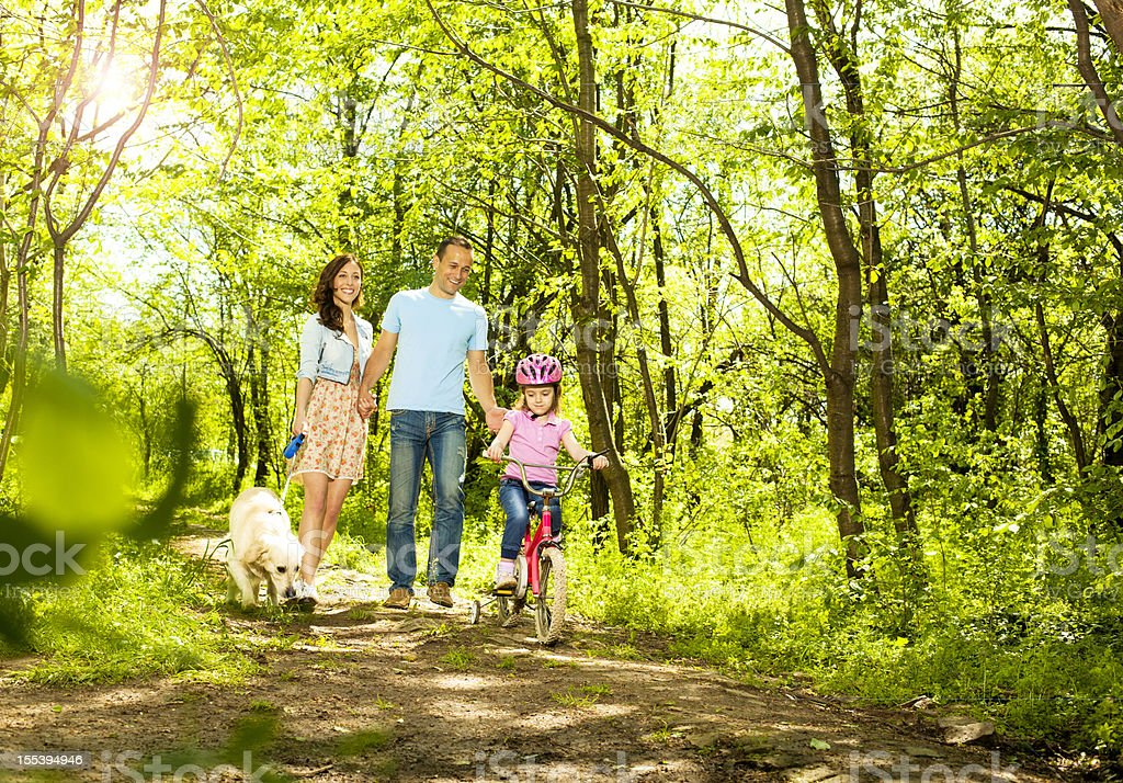 Family With Child Walking and cycling in a forest. royalty-free stock photo