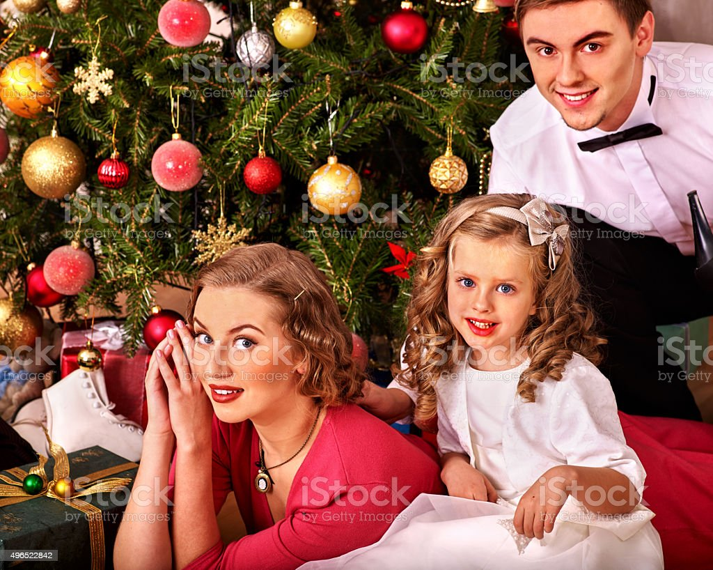 Family with children  dressing Christmas tree stock photo