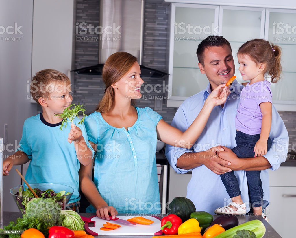 Family with children making dinner together royalty-free stock photo