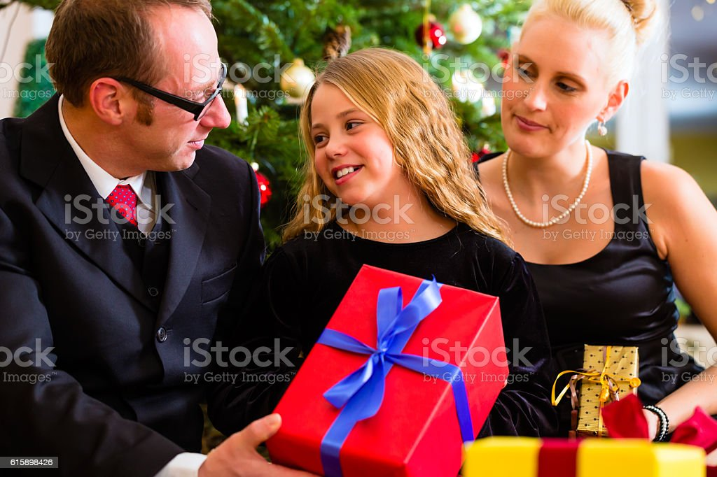 Family with Christmas gifts on boxing day stock photo