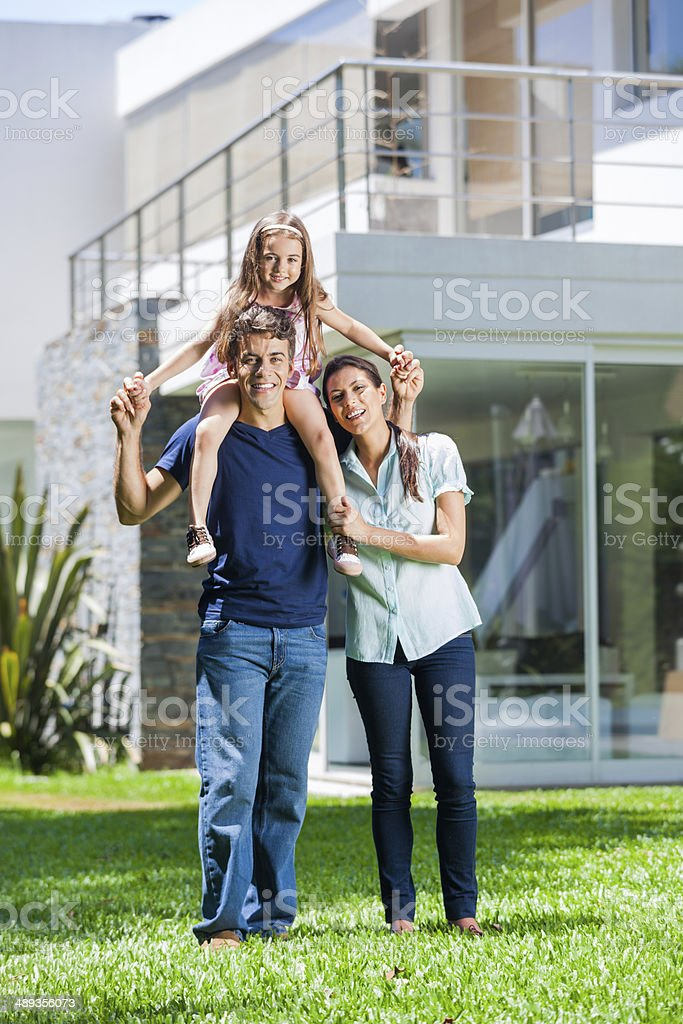 Family with daughter in front house stock photo