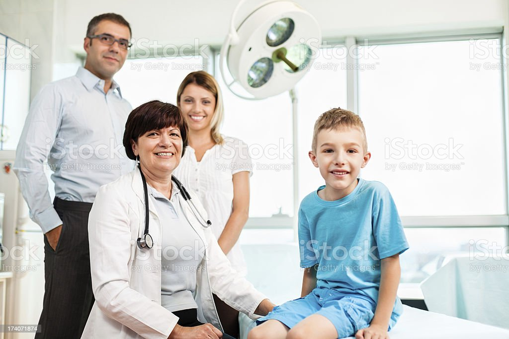 Family with doctor in doctor's office royalty-free stock photo