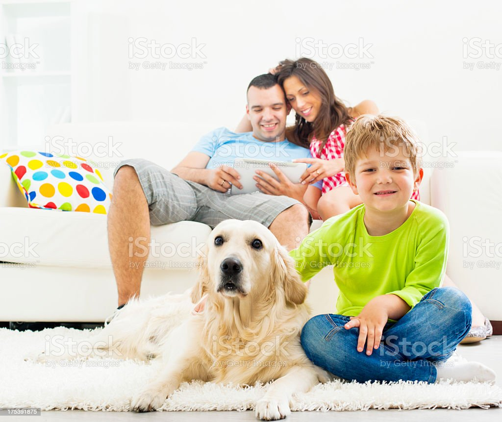 Family with dog enjoy at home. royalty-free stock photo