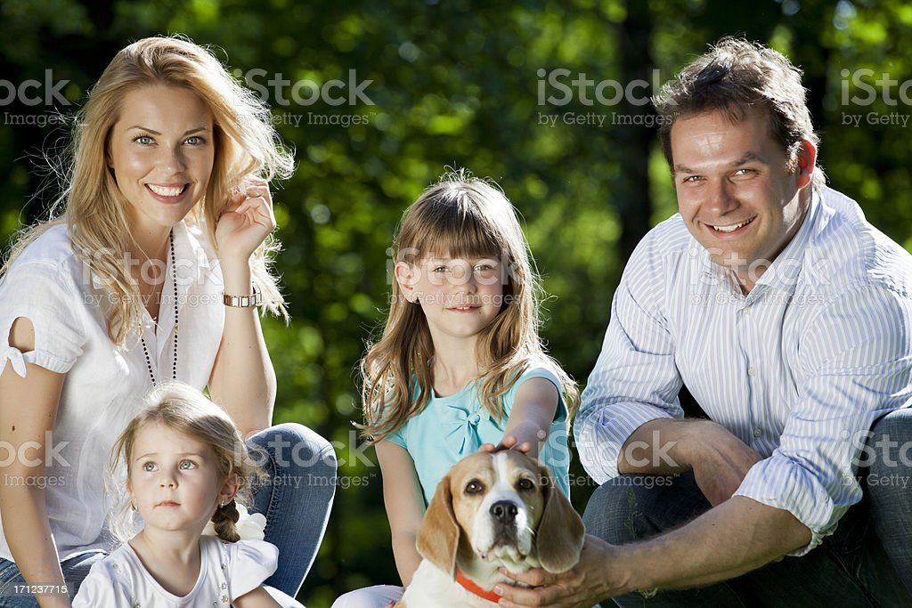 Family with dog royalty-free stock photo