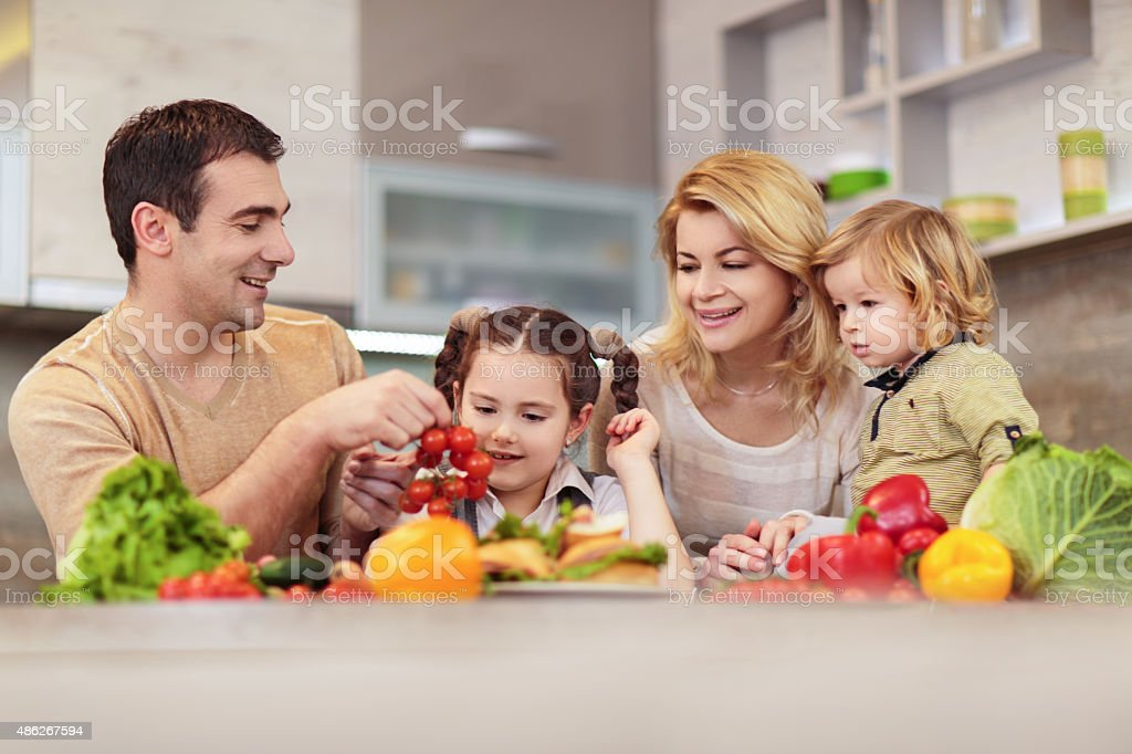 Family with healthy food in the kitchen. stock photo