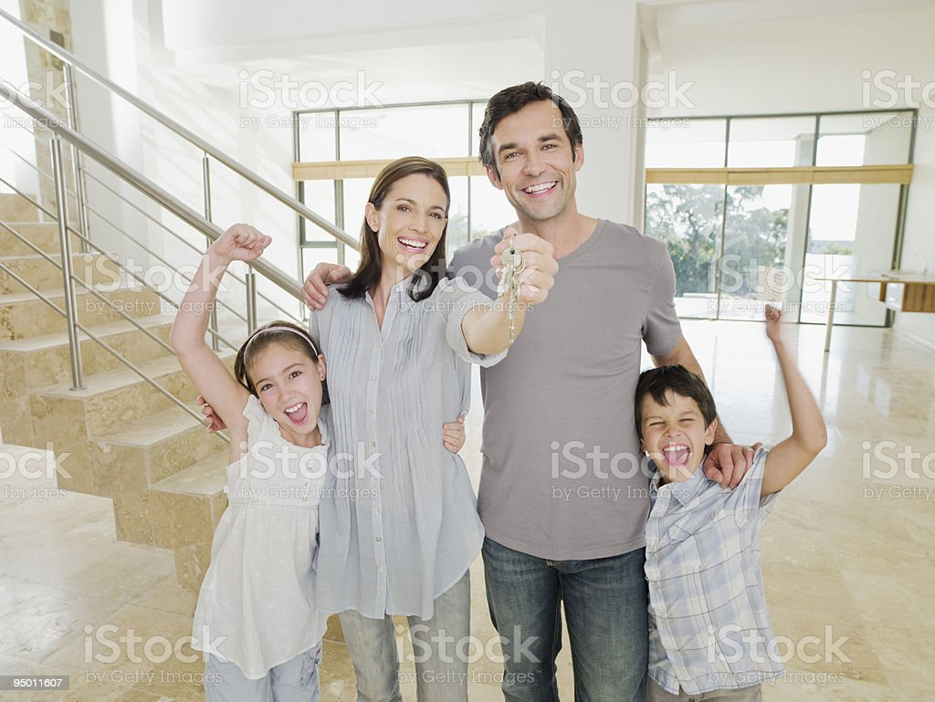 Family with keys celebrating new home royalty-free stock photo