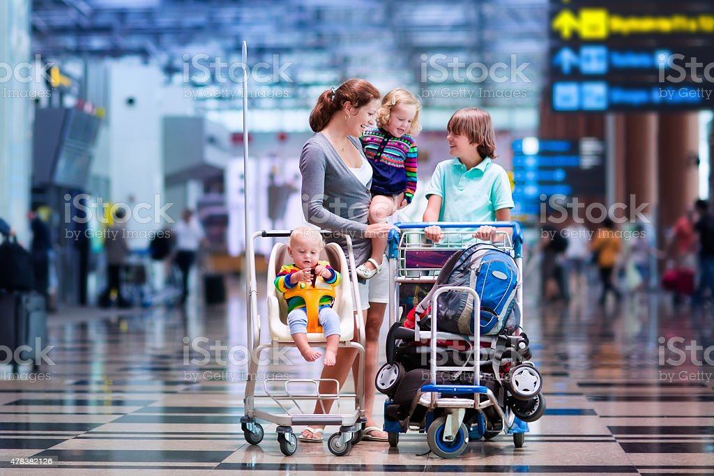 Family with kids at airport stock photo