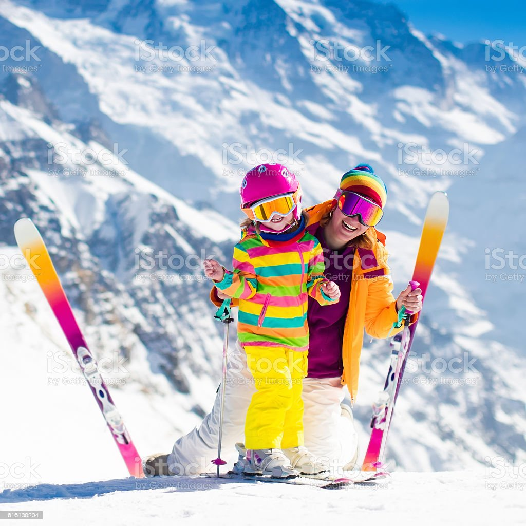 Family with kids in Swiss Alps mountains stock photo