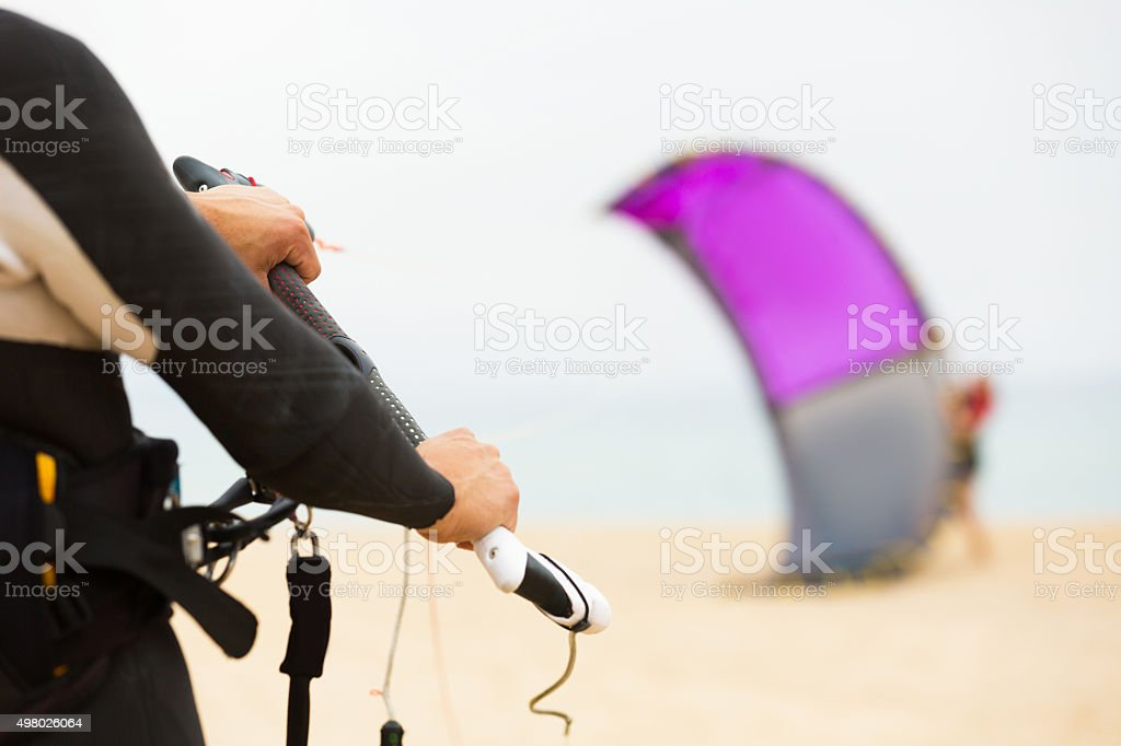 Family with kiteboard at the beach stock photo