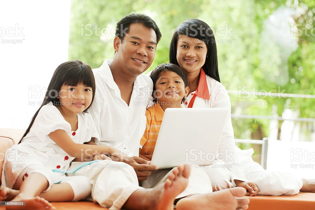 Family with laptop computer. royalty-free stock photo