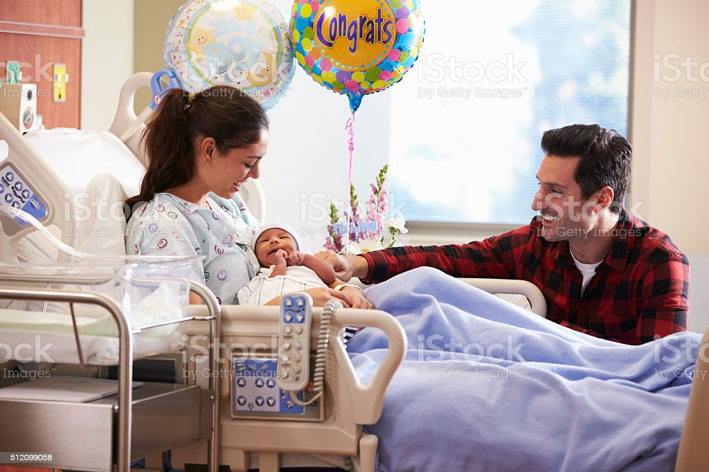 Family With New Born Baby In Post Natal Hospital Department stock photo
