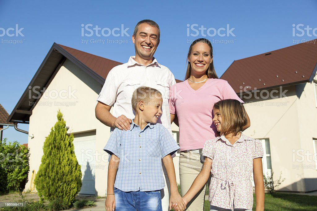 Family with new home royalty-free stock photo