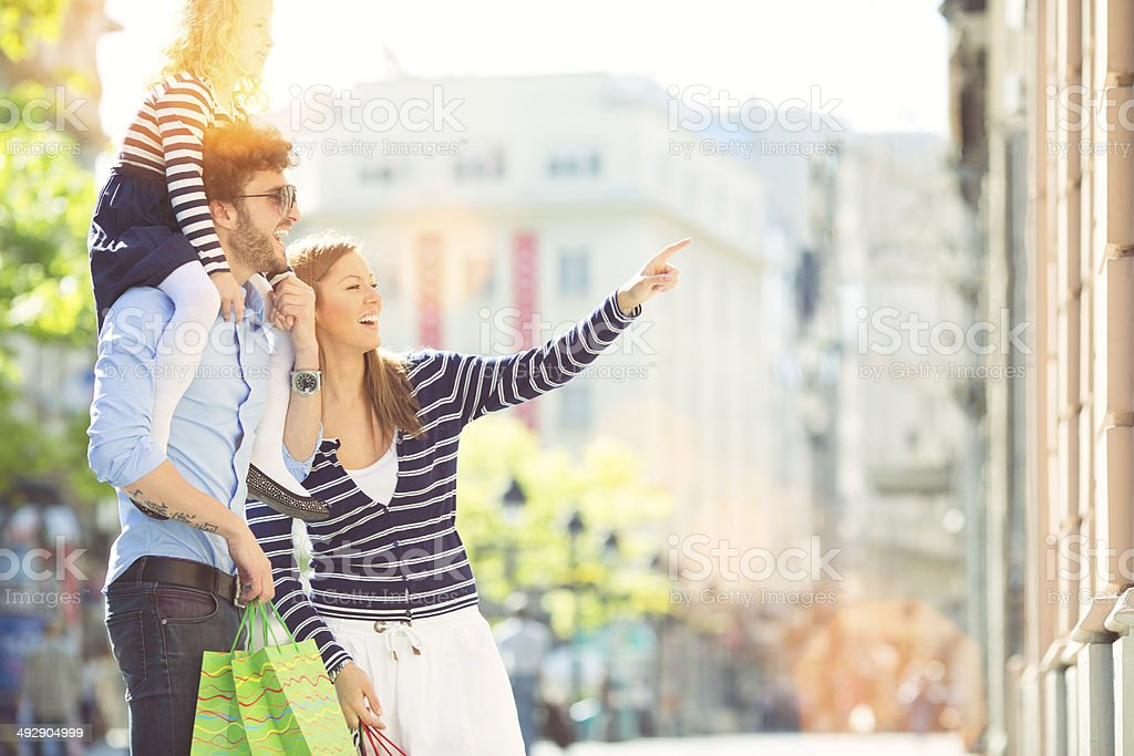 Family with One Child Enjoy Shopping Together. stock photo