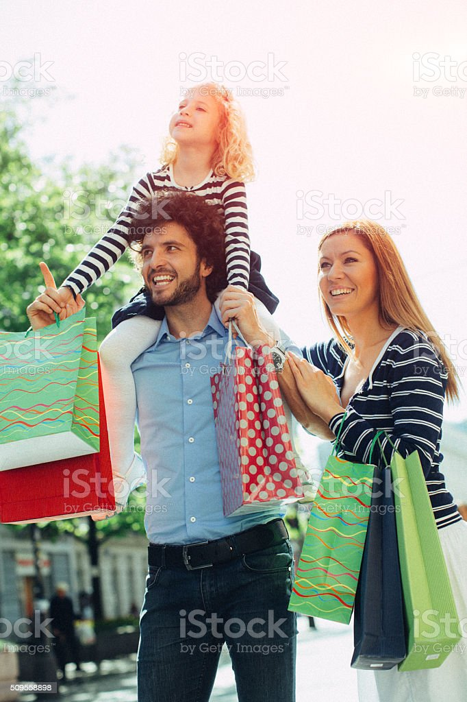 Family with One Child Enjoy Shopping Together stock photo