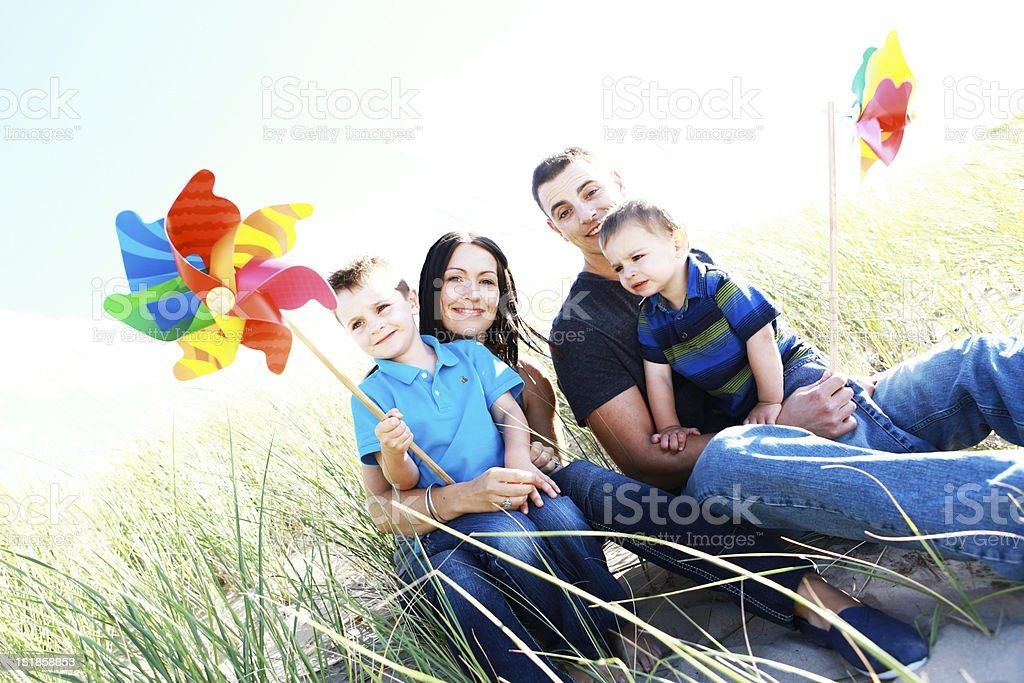 Family with Pinwheels at the Beach royalty-free stock photo