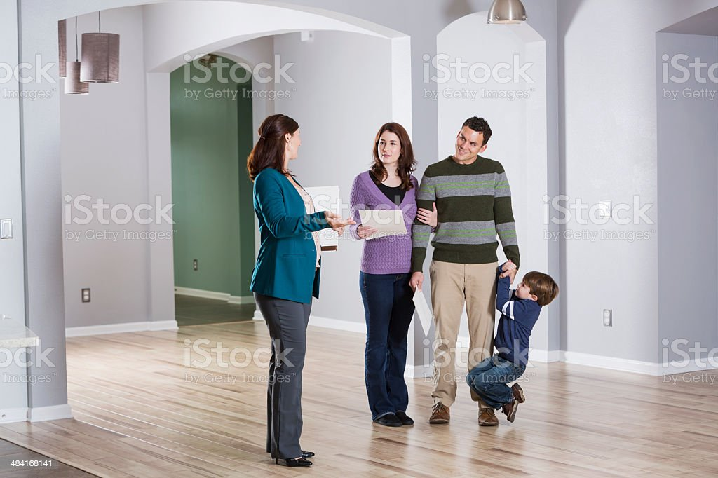 Family with real estate agent stock photo