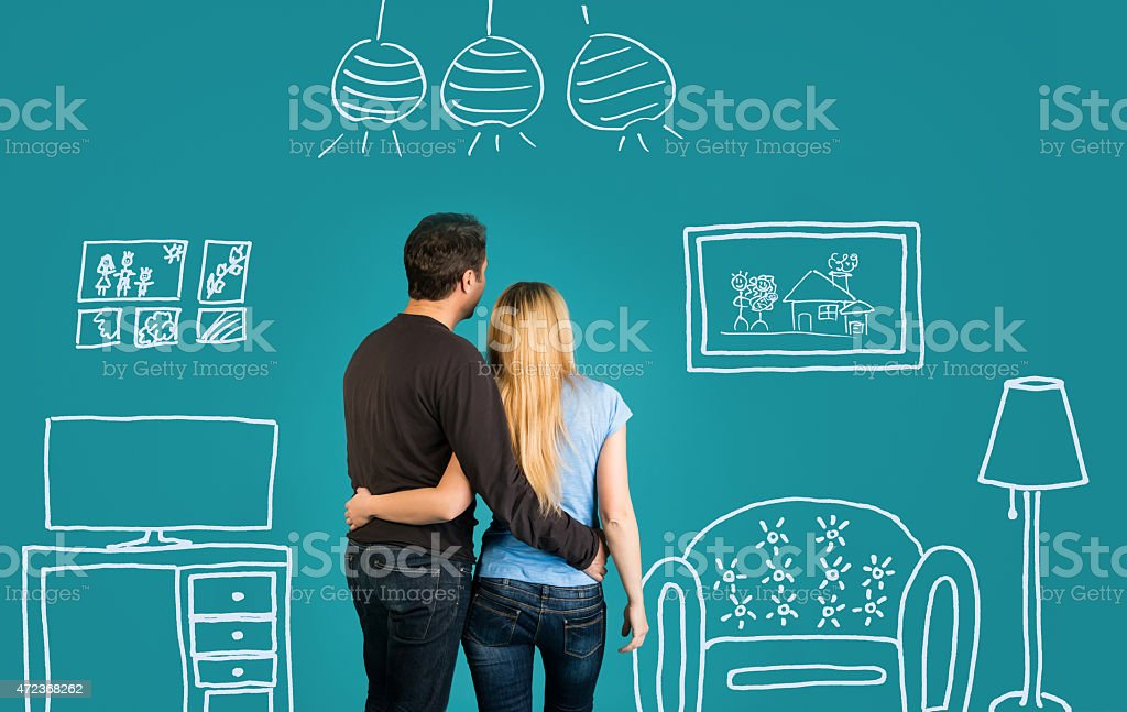 Family With Sketch Drawing Of Their Future Flat Interior. stock photo