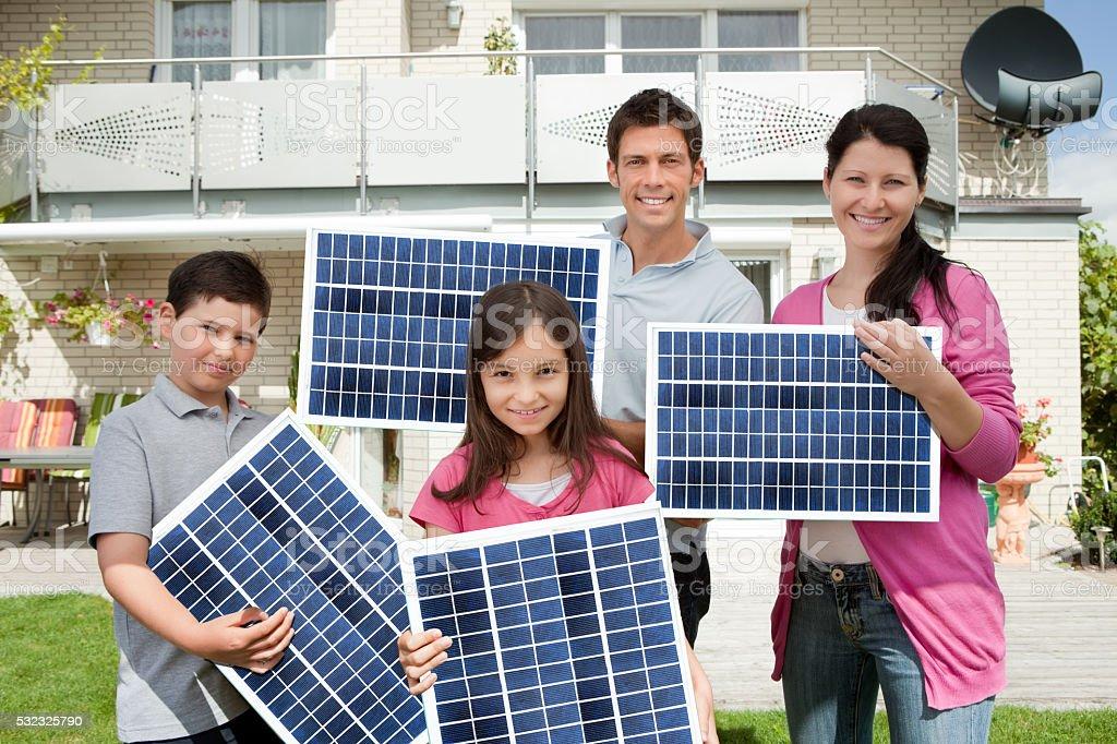 Family With Solar Panels stock photo