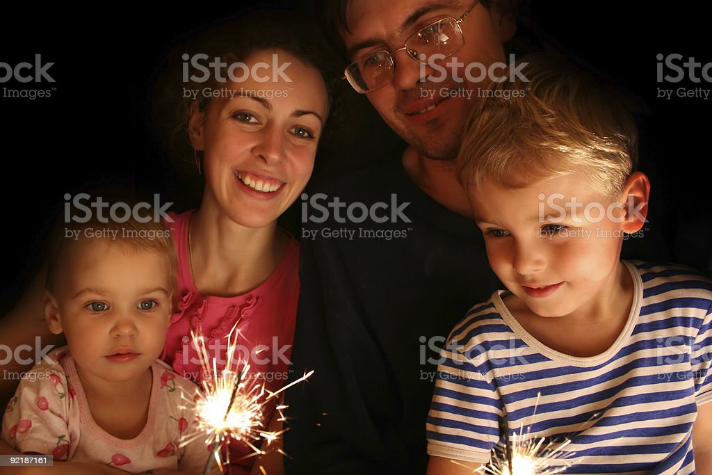 family with sparkler royalty-free stock photo