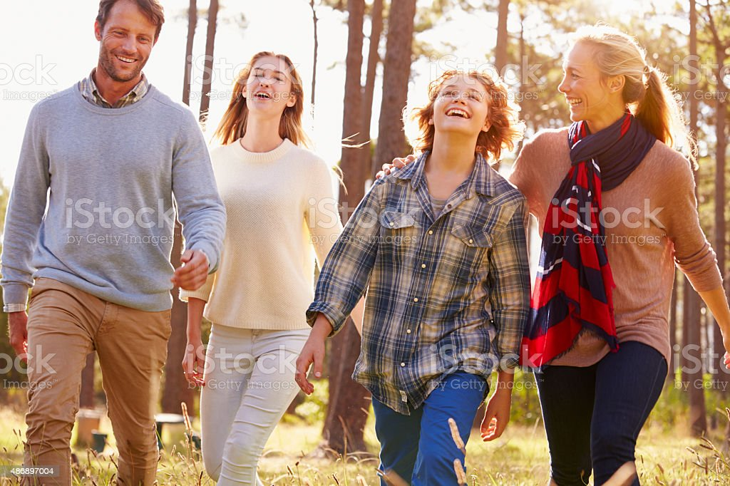 Family with teenage kids walking in countryside, close up stock photo