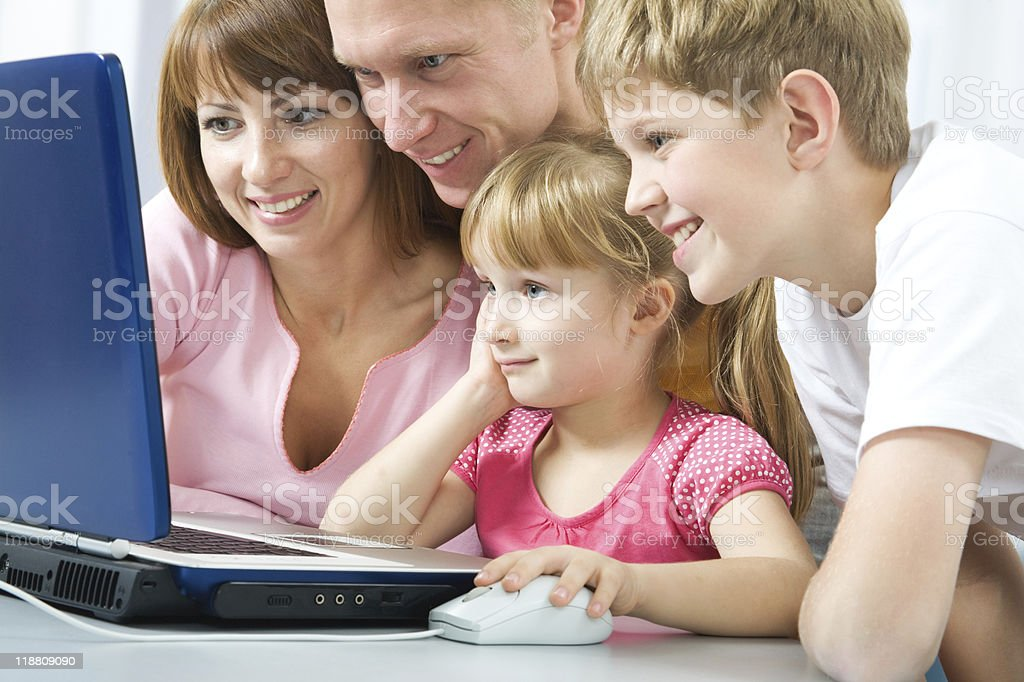 Family with the laptop royalty-free stock photo